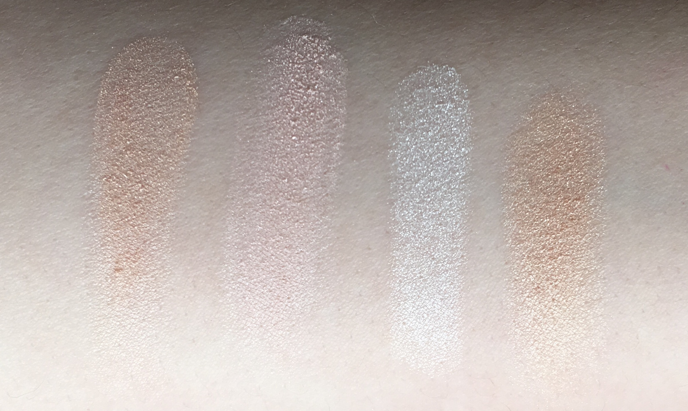 L-R: Kevyn Aucoin Candlelight, Hourglass Incandescent Light, Becca Pearl Pressed, Charlotte Tilbury Filmstar Bronze & Glow